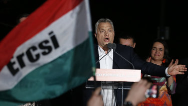 Hungarian Prime Minister Viktor Orban addresses his supporters in Budapest on Sunday.