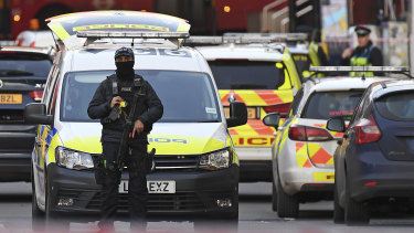 An armed Police officer blocks a street on the south side of London Bridge in London after the attack on Friday.