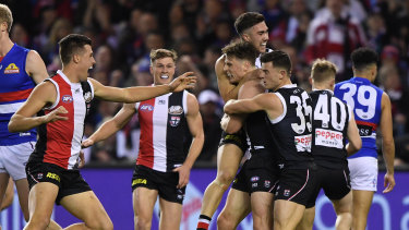 Sparkling debut: Doulton Langlands (fourth from right) celebrates his first goal for St Kilda during their win over Melbourne at Marvel Stadium in Melbourne.
