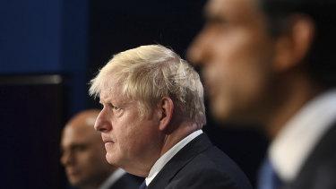 Britain's Health Secretary Sajid Javid, Prime Minister Boris Johnson and Chancellor of the Exchequer Rishi Sunak.