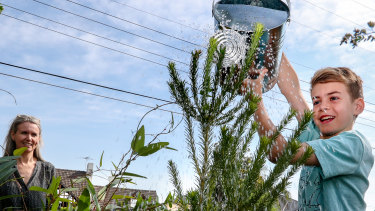 Kellie Parkin and her son, Bodhi Houlihan, 11, save water by using a watering can instead of a hose on their garden.
