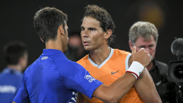 Novak Djokovic and Rafael Nadal embrace after the Serb beat his nemesis in straight sets in the Australian Open final last January.