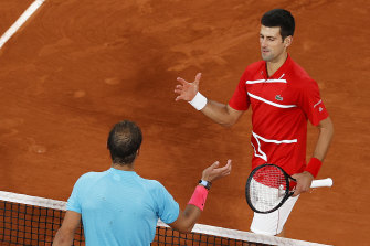 Rafael Nadal, left,  shakes hands with Novak Djokovic, right, after winning another French Open.