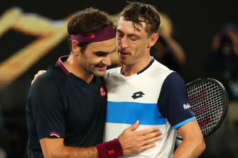 John Millman, right, congratulates Roger Federer after their third-round showdown at the Australian Open.