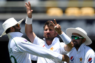 Count them:  Yasir Shah, centre, gives Steve Smith a pointed send-off at the Gabba.