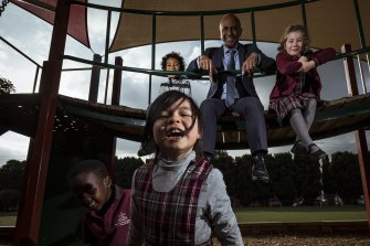 Trinity Catholic Primary School Principal Nigel Rodrigues  and students Dafalla, Cesafino, Isabel and Sophie.