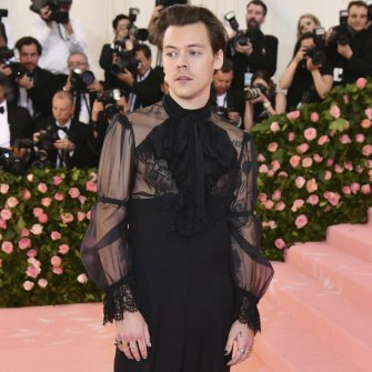 Harry Styles, laced up, at the Met Gala in 2019.