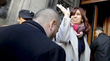 Senator and former president Cristina Kirchner waves as she enters Congress in Buenos Aires on Wednesday.