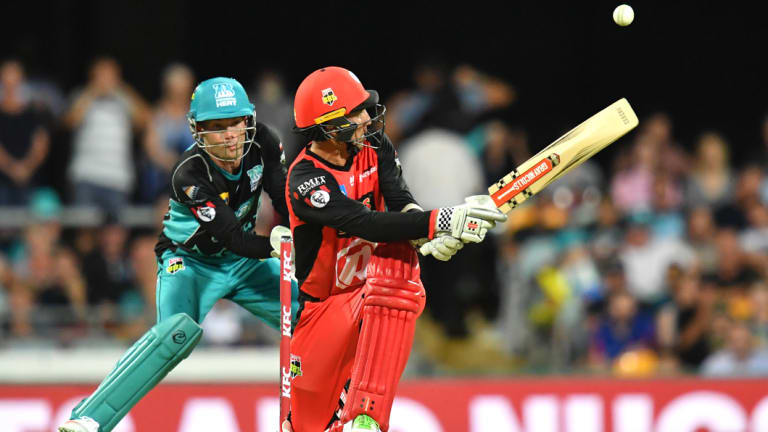 Clean sweep: Tom Cooper of the Renegades in action against Brisbane Heat at the Gabba.