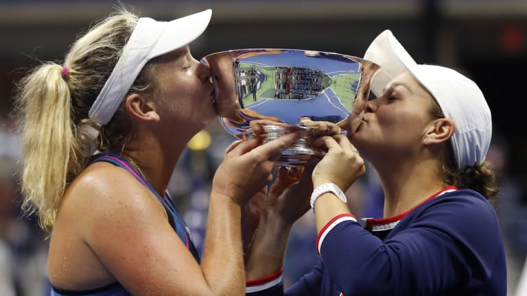Triumph: Australia's Ashleigh Barty (right) and CoCo Vandeweghe with the spoils of victory following the US Open women's doubles final.
