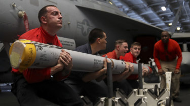 Aviation ordnance men transport a missile aboard the Nimitz-class aircraft carrier USS Abraham Lincoln. The aircraft carrier strike group is being deployed to the Persian Gulf to counter an alleged but still-unspecified threat from Iran.