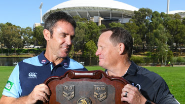 Let's get the party started ... NSW coach Brad Fittler, pictured here with Queensland counterpart Kevin Walters, wants Origin to restart the NRL season.