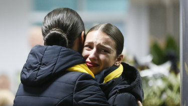 Ukrainian Airlines flight attendants grieve for the victims of the disaster.