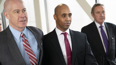 Former Minneapolis police officer Mohamed Noor, centre, has been charged with killing Australian Justine Ruszczyk Damond.