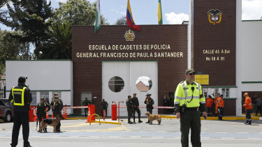 Police stand outside the General Santander police academy after a deadly bombing inside in Bogota on Thursday.
