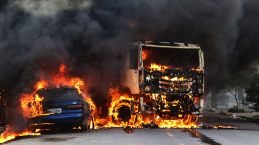 Vehicles burn in the street after attacks in the city of Fortaleza, north-eastern Brazil.