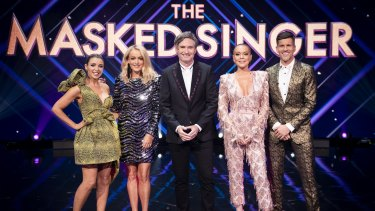 The Masked Singer Australia judges (from left) Dannii Minogue, Jackie O, Dave Hughes and Lindsay Lohan, with host Osher Günsberg.