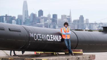 Boyan Slat beside the ocean barrier that will be deployed in the Pacific Ocean.