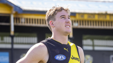 Game ready: Tigers recruit Tom Lynch in front of the Jack Dyer Stand at Punt Road Oval.