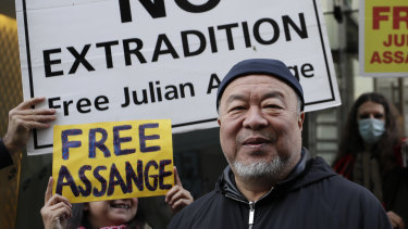 Chinese artist Ai Weiwei stands with protesters outside the Old Bailey in London.
