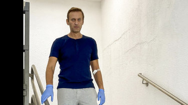 Russian opposition leader Alexei Navalny walks downstairs in a hospital in Berlin, Germany, on Saturday.
