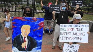Protesters outside the White House on Friday.