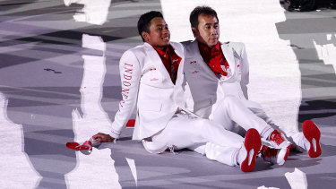 Indonesia athletes look on during the opening ceremony.