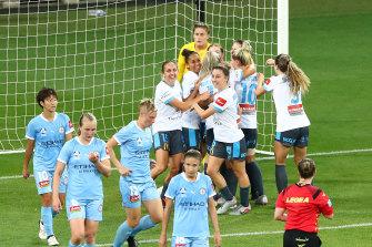 Sydney FC celebrate going 2-0 up after a Natalie Tobin goal against Melbourne City at AAMI Park on Thursday night.