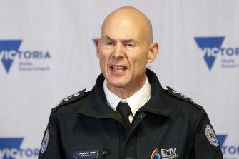 Emergency Management Commissioner Andrew Crisp speaks to the media on Friday