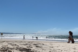 Smoke from a bushfire near Tweed Heads could be seen from Byron's Main Beach.