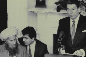 "November 12, 1987: US president Ronald Reagan tells a White House audience that mujahideen leader Yunus Khalis (left) represents ""a nation of heroes"". Translating for Khalis is State Department official Zalmay Khalilzad, now the Trump administration's envoy to Afghanistan."