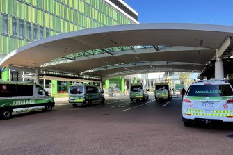 Ambulances wait outside of the emergency department at Sir Charles Gairdner Hospital in March.