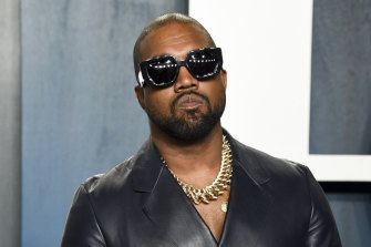 Kanye West, pictured in February at the Vanity Fair Oscar Party, has won his battle with Forbes to be judged a billionaire.