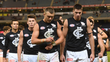 Still feeling Blue: (L-R) Jack Silvagni, Sam Walsh, Patrick Cripps and Matthew Kreuzer lead Carlton off the field after their loss to the Bombers.