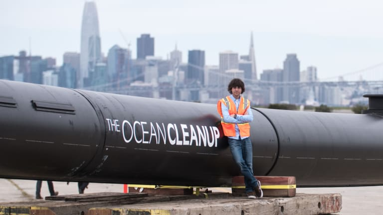 Boyan Slat beside the ocean barrier that will be deployed in the Pacific Ocean.