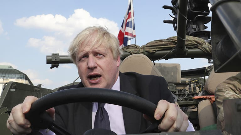 Boris Johnson, pictured in June, has launched a scathing attack on the Chequers plan leading to speculation he's positioning himself for a leadership tilt.