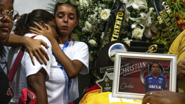 Friends and relatives attend the burial of promising star Christian Candido in Rio on Sunday.