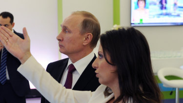 Russian President Vladimir Putin and with editor-in-chief of RT, Margarita Simonyan, in 2015.
