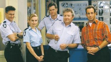 Original cast of Blue Heelers Grant Bowler, Lisa McCune, William McInnes, John Wood and Martin Sacks.