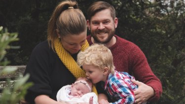 Katie Woodward with her husband Blake Woodward with baby Michaela and Samuel.