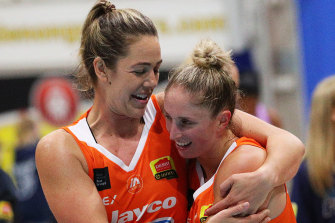 Jenna O'Hea (left) embraces Flyers teammate Rebecca Cole in the win over the Boomers.