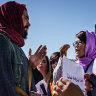 Taliban beat protesters and arrest journalists at women's rally in Kabul