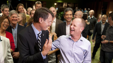Lord mayor Graham Quirk and Campbell Newman celebrate after Cr Quirk won the election in 2012.