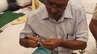A darner repairs a shawl.