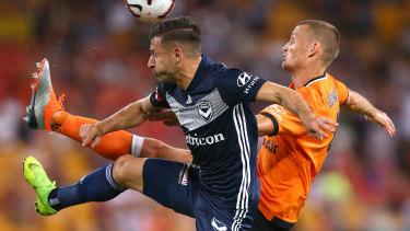 Kosta Barbarouses battles with Brisbane's Daniel Bowles.