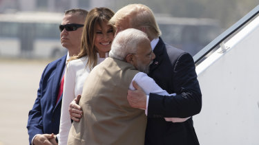 Trump is embraced by  Modi, with first lady Melania Trump, as they step off Air Force One upon arrival at Sardar Vallabhbhai Patel International Airport.