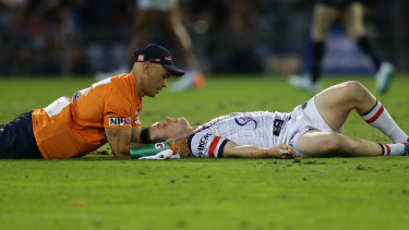 Down and out: Luke Keary receives attention after suffering a concussion.
