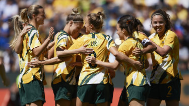 The Matildas celebrate a goal this month against Chile.