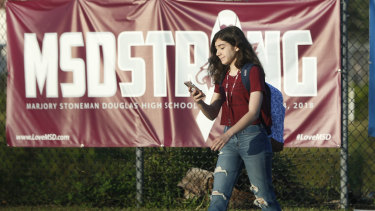 "A student walks past an ""MSDSTRONG"" banner on the way to class at Marjory Stoneman Douglas High School."