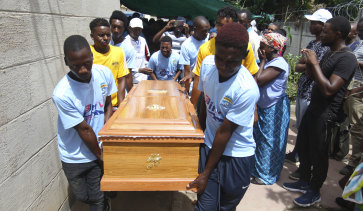 Kelvin Tinashe Choto's soccer teammates carry his coffin. The 22-year-old was shot in the head during a violent security crackdown.